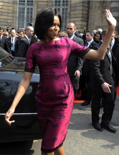 Michelle Obama waving in purple dress